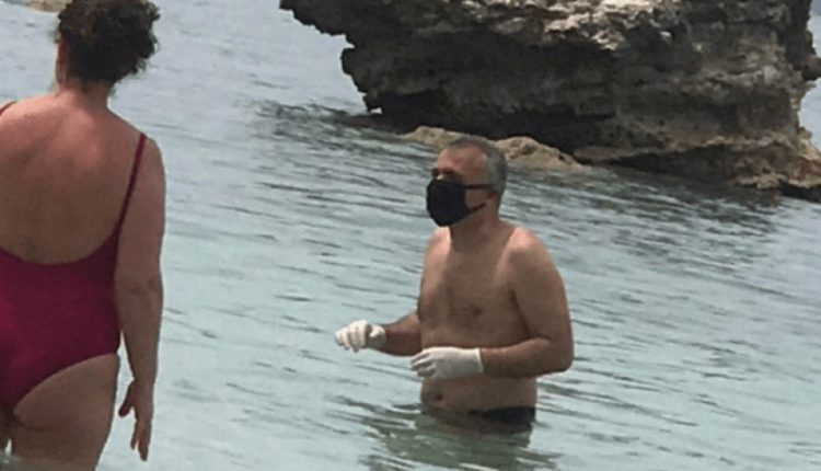 Vlora nis plazhin, not me maskë dhe doreza